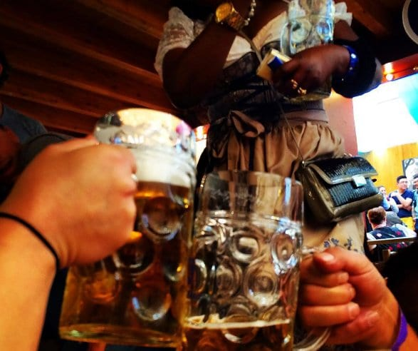 Everything you need to know about  tips for traveling to Oktoberfest in Munich, Germany and general festival information. What costume or outfit to wear, where to stay, where to party, what beer tents to visit, food to eat, and activities beyond drinking + pictures to inspire your trip! Dirndl and lederhosen required! #oktoberfest #munich #gemany #festival #festivals